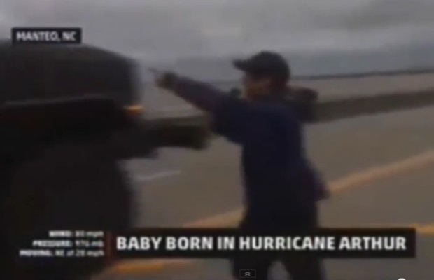 Weatherman trys to talk to a woman in labor…in the middle of a hurricane!